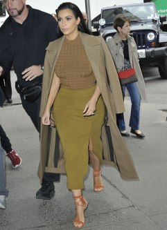 kim-kardashian-in-tan-coat-checked-top-mustard-skirt-1-2