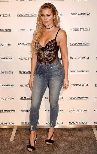 http://hollywoodlife.com/pics/khloe-kardashian-sexy-pictures-hottest-photos/#!1/khloe-kardashian-lace-body-suit-ftr/